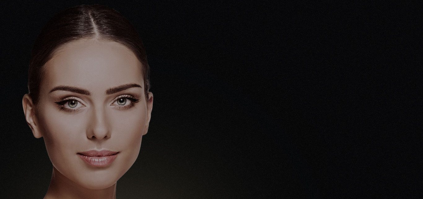Womans face on black background